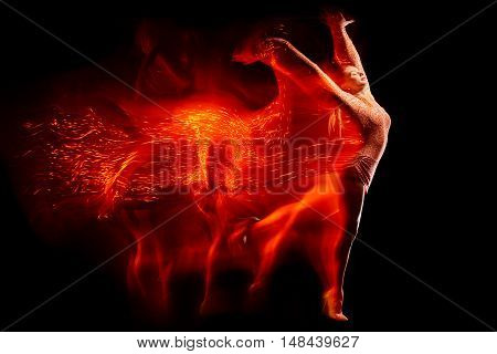 Fine art portrait of beautiful woman dancer in red sparkles. Mixed lighting photography.