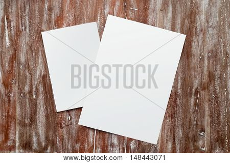 Closeup Two Blank White Paper Sheet Mockup Natural Wood Table Background. Empty Canvas Painted Brown Desk