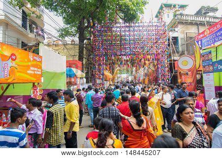 KOLKATA INDIA - OCTOBER 21 2015 : Crowd enjoying Durga Puja festival on road at Kolkata West Bengal India. Durga Puja is biggest religious festival of Hinduism.