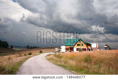 dramatic view at small house on Durmitor National Park plateu.