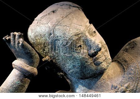 Ancient bronze statue of reclining Vishnu from West Mebon, Angkor, Cambodia