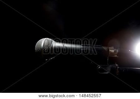 Black Microphone On Dark Background.