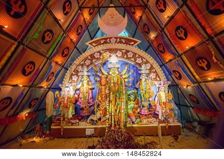 KOLKATA INDIA - OCTOBER 21 2015 : Beautiful interior of decorated Durga Puja pandal at Howrah West Bengal India. Durga Puja is biggest religious festival of Hinduism.