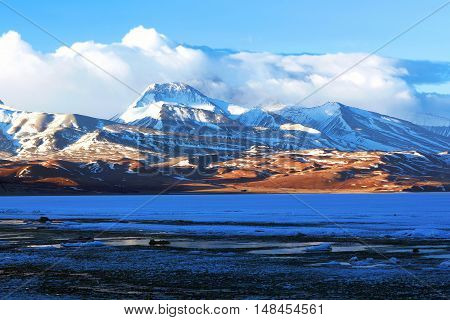 Gurla Mandhata mount and Rakshas Tal lake under ice in Western Tibet