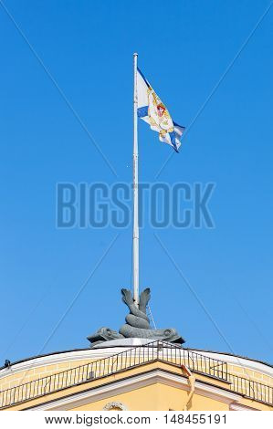 St. Andrew's flag waving in the wind on the Admiralty building in St. Petersburg Russia