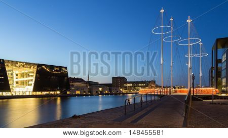 Panoramic nightshot of the modern Circle Bridge and the Royal Library in Copenhagen, Denmark