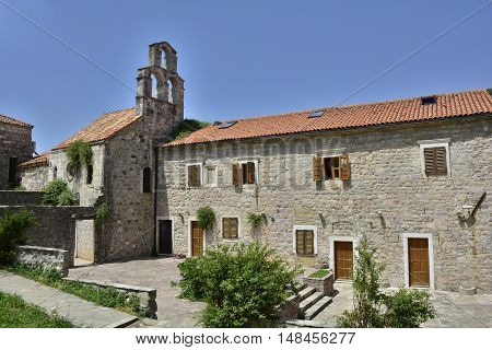 The Pre-Roman church of Santa Maria in Punta was built in Budva in 840 by the Benedictines was later taken over by the Franciscans.