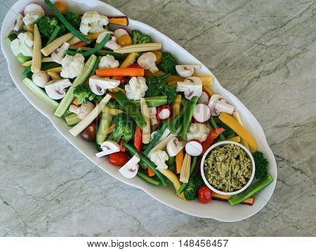 Vegetable Crudites and Dip/ vegetable platter on stone, marble background, healthy eating, top view.