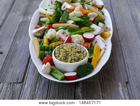 Vegetable Crudites and Dip/ vegetable platter on wood background, healthy eating, selective focus, close-up.