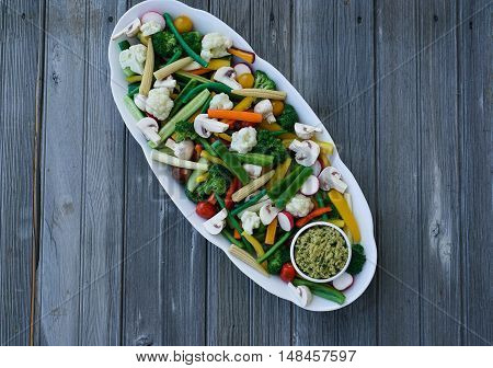 Vegetable Crudites and Dip/ vegetable platter on wood background, healthy eating, top view.