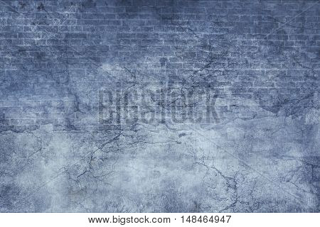 Blue stucco and brick vintage old grunge texture with cracks and scratches