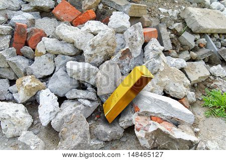 heap of rubble trash and gold bar