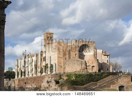 Temple of Venus and Roma ancient ruins with apse and columns at the entrance of Roman Forum