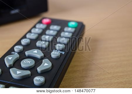 The hd player and remote control on wood a table
