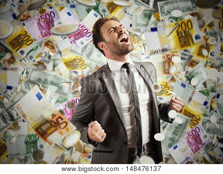Concept of success and career of a businessman with rainy banknotes