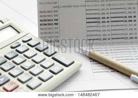 Concept of savings : Pen and calculator on savings account passbook