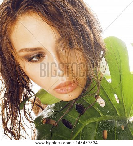 young brunette elegant woman with green leaf isolated on white close up asian face, spa concept