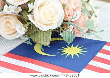 National day : Malaysia flag and flower on tablecloth