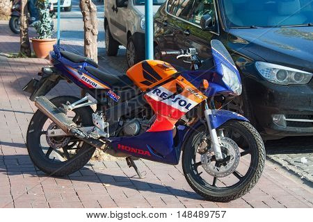 TURKEY ALANYA - NOVEMBER 10 2013: Sportbike Honda in official factory team Repsol Honda colors parked on the street in the center of Alanya. Turkey.