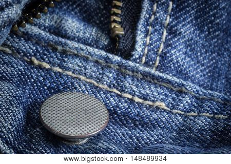 Closeup of texture background jean zipper and button. You can apply for jean background, jean backdrop, jean wallpaper and everything about jean background for you design
