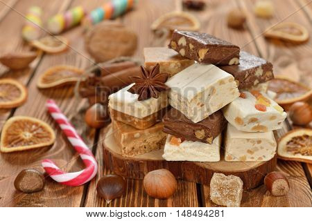 Various Christmas nougat on a brown background
