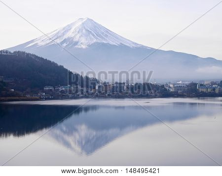 Mount Fuji reflection in Lake Kawaguchi in foggy morning.  Yamanashi Prefecture. Fuji Five Lakes. Japan.