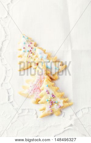 Christmas butter cookies with icing and sugar pearls