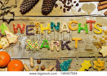 Christmas Decoration And Cookie Letters On Wooden Table, German Word