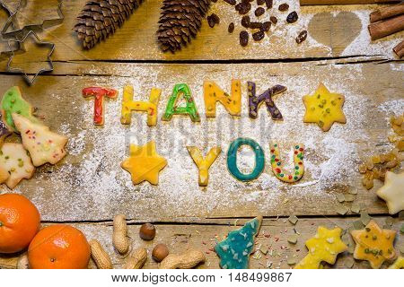 Cookie Letters With Christmas Decoration On Wooden Table, Thank You