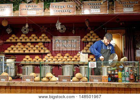 VIENNA AUSTRIA - NOVEMBER 21 2013: Christmas Market at Rathausplatz. Kiosk selling the traditional soup in bread.