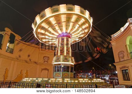 VIENNA AUSTRIA - NOVEMBER 23 2013: Carousel in motion at the Prater Amusement park at night.