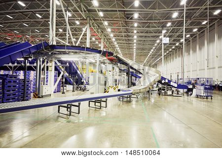 RUSSIA, MOSCOW - DEC 16, 2014: Employees working in the large post department of automated sorting center in Vnukovo. Moscow Automated sorting center - the largest in Eastern Europe.
