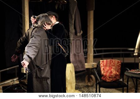 RUSSIA, MOSCOW - APR 15, 2015: Two actors are kissing and playing his characters for performance (Kosmos) at drama theatre Modern.