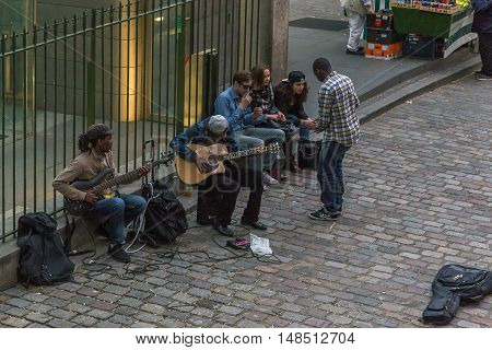 PARIS, FRANCE - MAY 12, 2015: It is a small concert buskers on the streets of Montmartre.