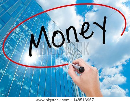 Man Hand Writing Money With Black Marker On Visual Screen