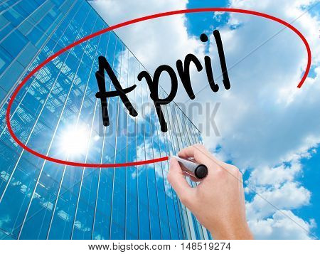 Man Hand Writing  April  With Black Marker On Visual Screen