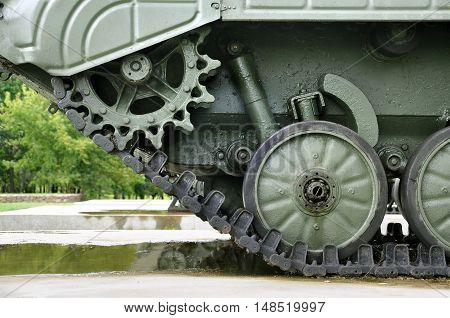 Chassis tank standing on the ground. Front view of crawler.