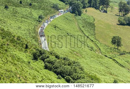 Col D'AspinFrance- July 152015: The peloton climbing the road to Col D'Aspin in Pyrenees Mountains during the stage 11 of Le Tour de France 2015.
