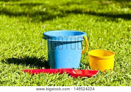 Kid toys. Buckets and shovel on the grass