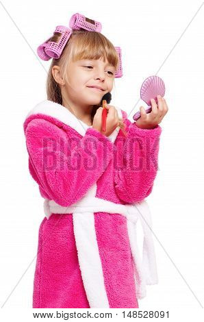 Adorable little girl playing with mommy's make up. Fashion little child applying make-up, isolated on white background. Kid learning to be a modern woman.
