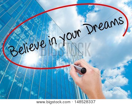 Man Hand Writing Believe In Your Dreams With Black Marker On Visual Screen