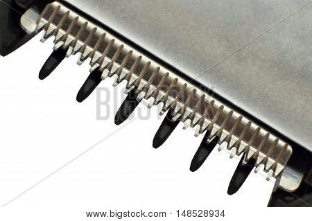 Hair trimmer blade taken closeup on white background.