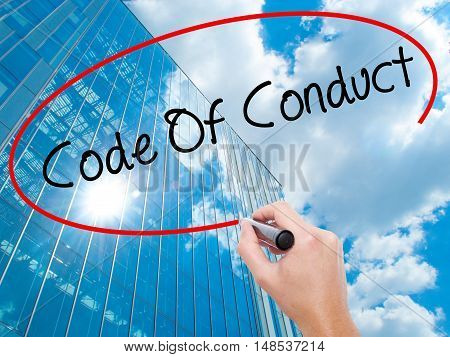 Man Hand Writing Code Of Conduct With Black Marker On Visual Screen