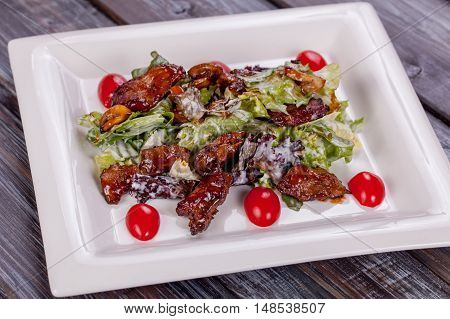 salad chicken in teriyaki sauce on white plate