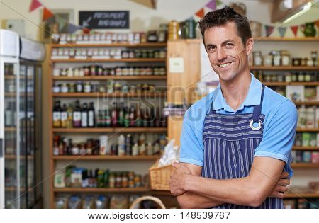 Portrait Of Male Owner Of Delicatessen Store