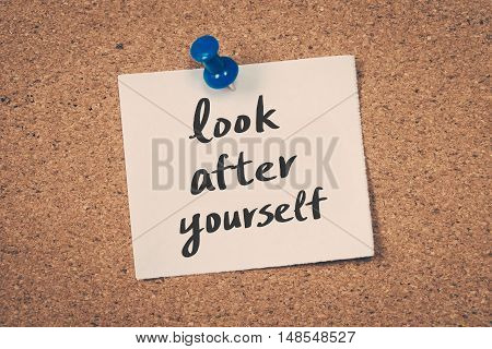 Look after yourself. note pin on the bulletin board