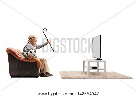 Ecstatic elderly man watching football on TV and cheering isolated on white background