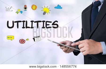 UTILITIES Businessman use a tablet computer businessman working