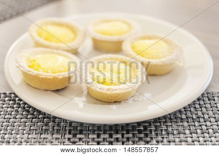 Fresh mini cakes with yellow filling foe dessert time