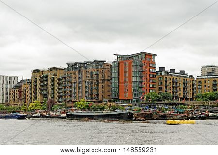 LONDON, ENGLAND - JULY 8, 2016: Bermondsey riverside - Prividence Square Providence Tower Springalls Wharf Apartments Tempus Wharf.